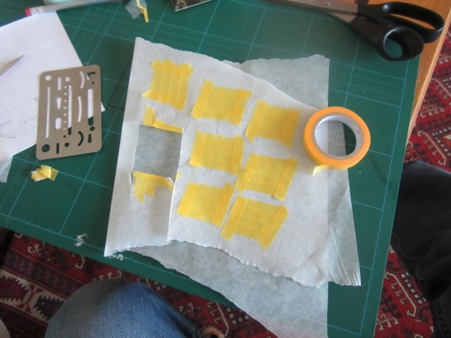 "Cutting the masking for the black stripes. This camouflage scheme was inspired by the film, ""Inception""."