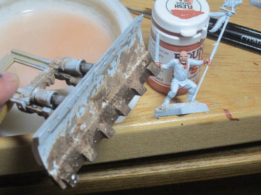 Start of muddying up the dozer blade. I used weathering products from AK Interactive.