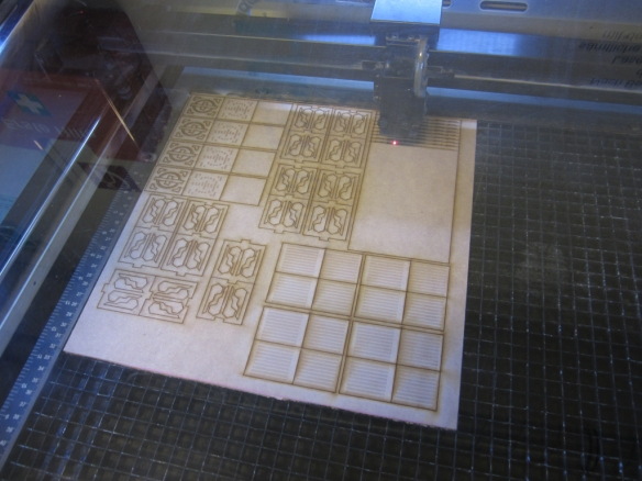 So here is the laser-cutter hard at work. As you can see I don't actually get that much out of a sheet because of the layers and complexity